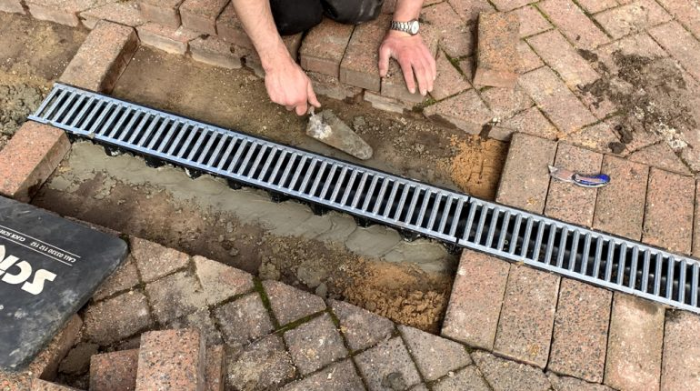 Driveway drain channel installation at an apartment block